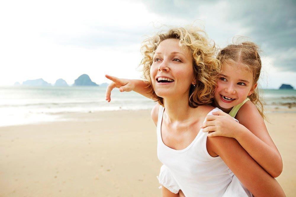 STE mother daughter piggyback beach