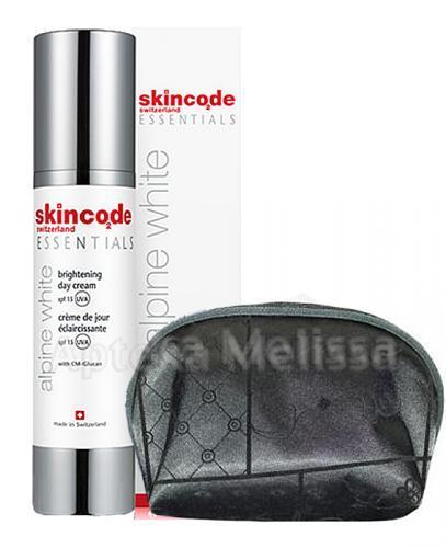 SKINCODE ESSENTIALS Krem rozjaśniający z ochroną przeciw UV SPF12 - 50 ml + Kosmetyczka